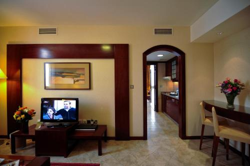 A television and/or entertainment center at Vision Hotel Apartments Deluxe