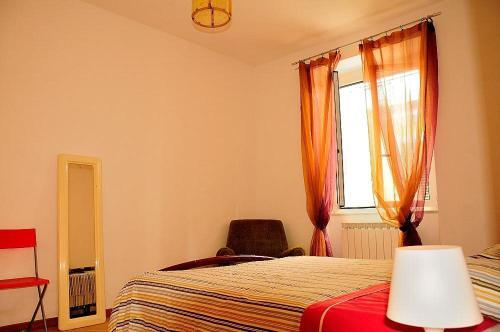 Ein Bett oder Betten in einem Zimmer der Unterkunft La Casa Gialla