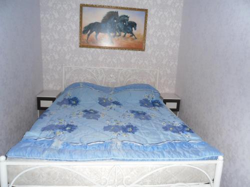 Кровать или кровати в номере Апартаменты на Жуковского,29А