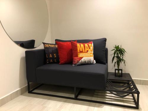 A seating area at Loft Moderno Berrini