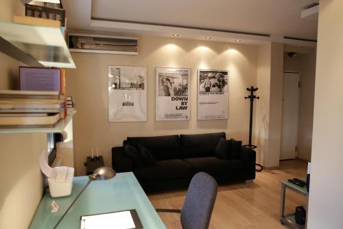 A seating area at Navarinou Loft Apartment