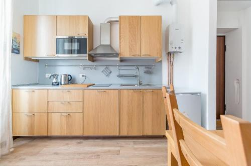 A kitchen or kitchenette at Alessia's Flat- Affori 3