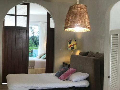 A bed or beds in a room at LiveTulum