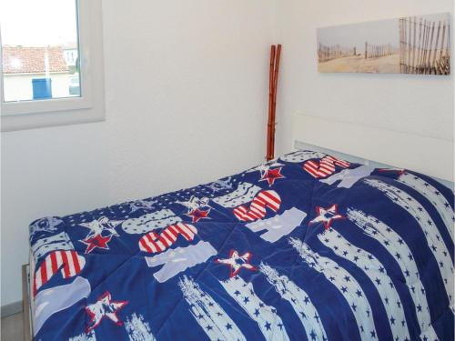 Un ou plusieurs lits dans un hébergement de l'établissement One-Bedroom Apartment in Gruissan