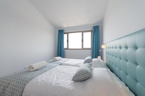 A bed or beds in a room at Balcón de Telde