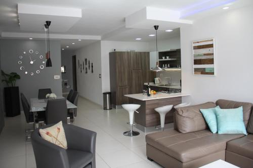A seating area at Interlace Apartment