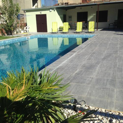 The swimming pool at or near Rooms Chill Out Beach