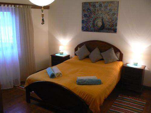 A bed or beds in a room at Casa Uldina