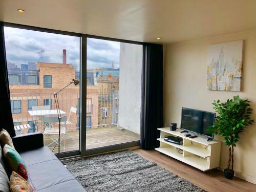 Et tv og/eller underholdning på City Short Stay Brick Lane Apartments