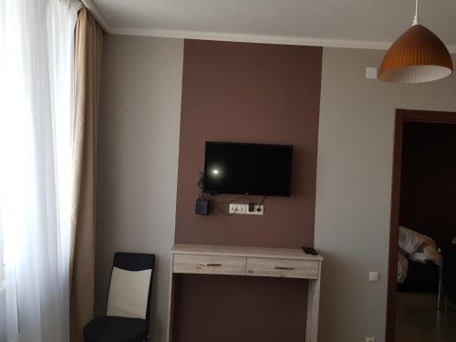 Una televisión o centro de entretenimiento en 1st Batumi
