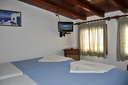 Ένα ή περισσότερα κρεβάτια σε δωμάτιο στο Fresh Rooms