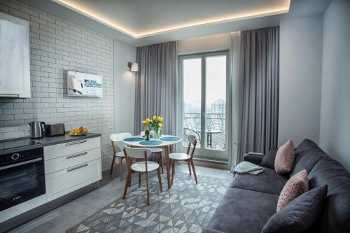 Гостиная зона в Apartments Belietazh