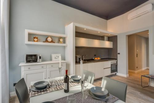 A kitchen or kitchenette at Cherubini Palace Thematic Apartment