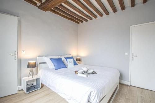 Un ou plusieurs lits dans un hébergement de l'établissement Luckey Homes - Place Saint Sauveur