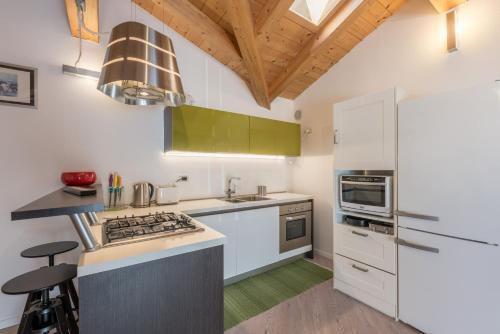 Küche/Küchenzeile in der Unterkunft Mansarda di Alex e Nataly