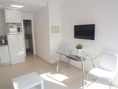A television and/or entertainment center at Costa Natura 602
