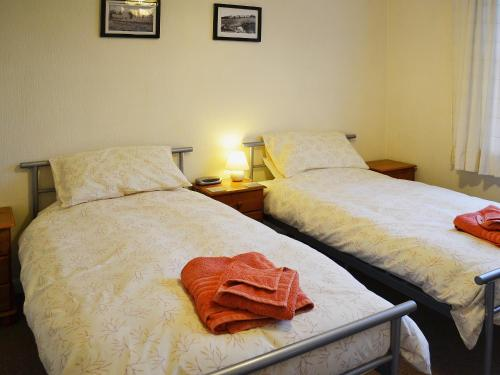 A bed or beds in a room at Fairlight