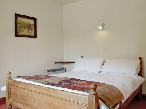 A bed or beds in a room at The Granary VI