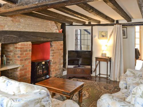 A television and/or entertainment center at Tudor Cottage