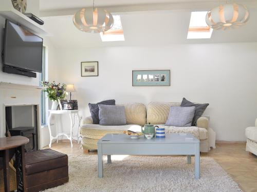 A seating area at Priory Cottage