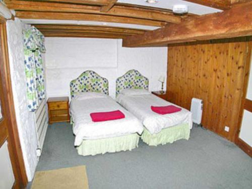A bed or beds in a room at Erbistock Mill