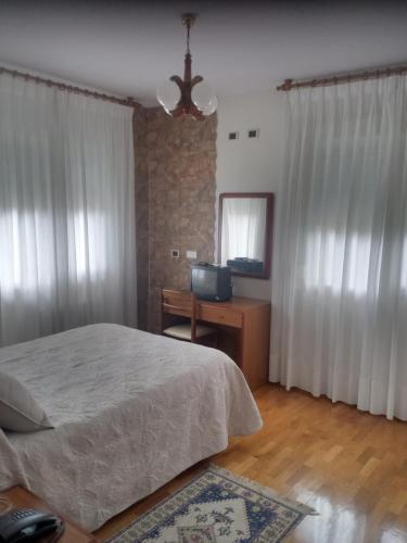 Un ou plusieurs lits dans un hébergement de l'établissement Hotel Arume