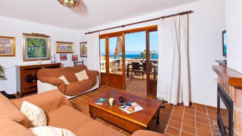 A seating area at Villa Alcanada Golf / Prats