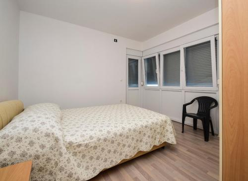 A bed or beds in a room at Vlahov Apartments