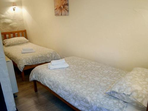 A bed or beds in a room at Willow
