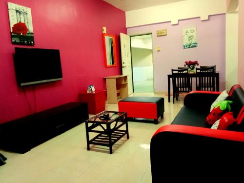 A television and/or entertainment centre at JC Apartment Sunshine Bay Resort Port Dickson