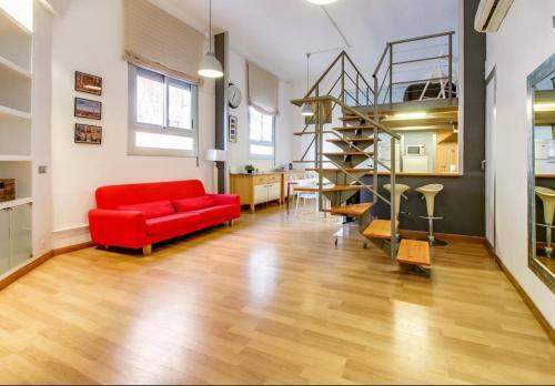 A seating area at Apartamento SleepingBCN Hol