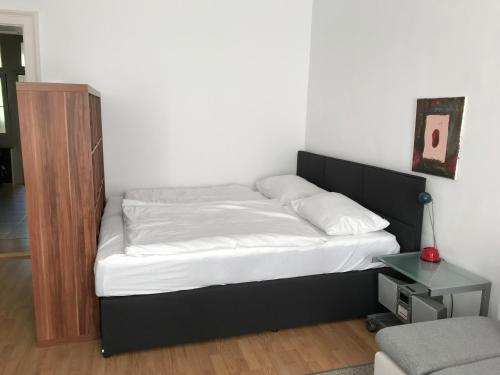 """A bed or beds in a room at Cosy Studio - TOP Location """"Soho"""""""