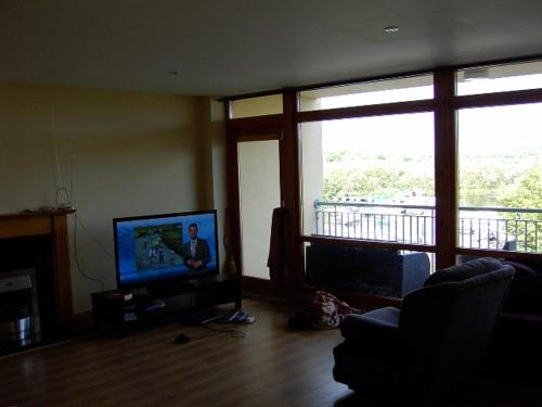 A television and/or entertainment center at Apt 13 The Waterfront