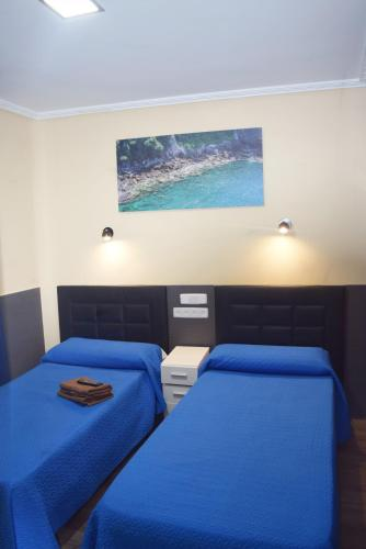 A bed or beds in a room at Hostal Numancia