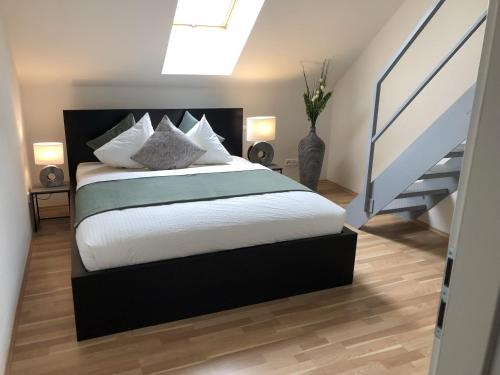 A bed or beds in a room at On The Top Apartments