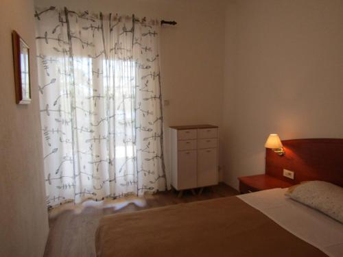A bed or beds in a room at Villa Nada