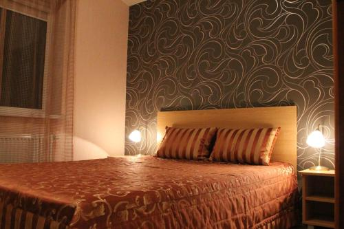 A bed or beds in a room at B Apartment in Vilnius