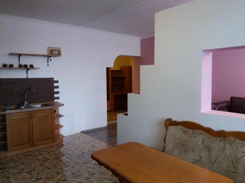 Зона вітальні в 3-к квартира
