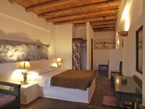 Ein Bett oder Betten in einem Zimmer der Unterkunft Villa Niki
