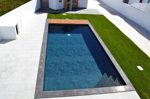 The swimming pool at or near Sea, Sun and Style House