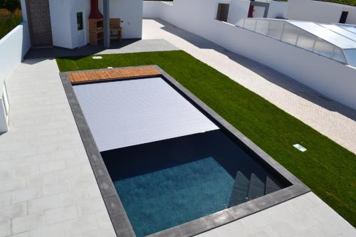 A view of the pool at Sea, Sun and Style House or nearby