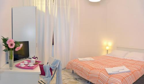 A bed or beds in a room at Tizi Apartments Corso Regina
