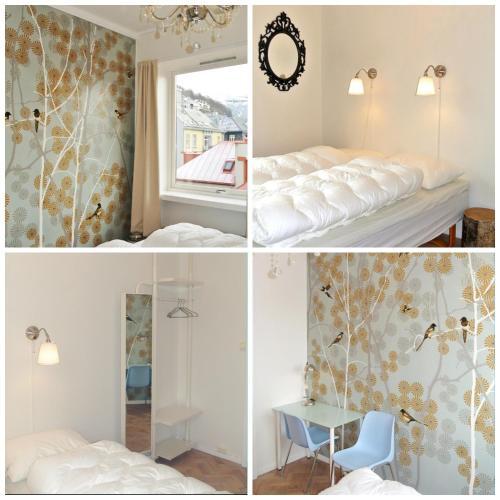 A bed or beds in a room at Marken Guesthouse