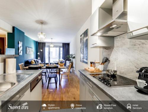 Cuisine ou kitchenette dans l'établissement Sweet Inn Apartments-EU Parliament