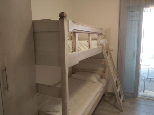 A bunk bed or bunk beds in a room at Karantola Studios Kallirachi