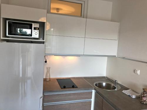 A kitchen or kitchenette at Apartments Nela