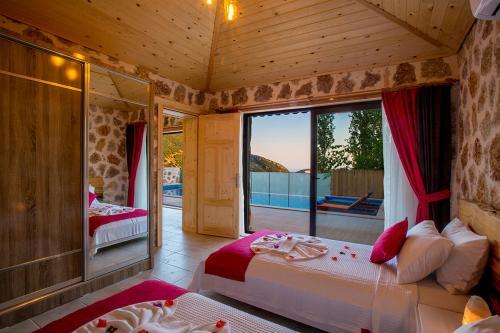 A bed or beds in a room at Villa Otantik
