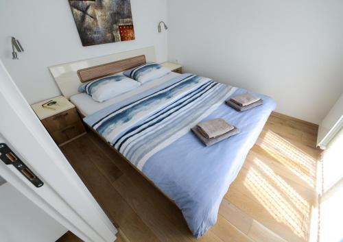 Katil atau katil-katil dalam bilik di Srecko Exclusive Apartment