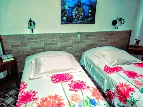 A bed or beds in a room at Yoly y Charlie