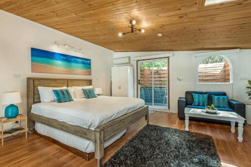 Gulta vai gultas numurā naktsmītnē Long Beach House Apartments